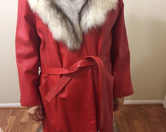 1960s Great condition red leather coat with fur accents. Luxury womans coat. Full length.