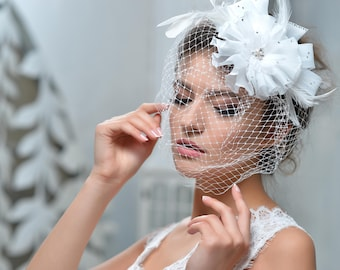 Bridal headpiece hair comb with bridal  birdcage veil from NYC Bride