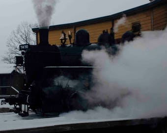 Photograph of steam locomotive coming out strong!