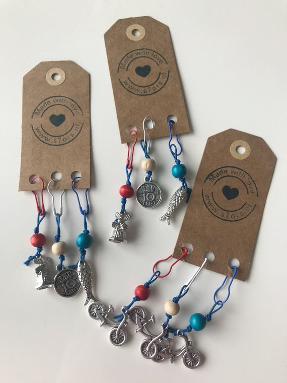 3 Holland inspired stitch markers. Bicycles or mill, coin and herring. With red, white and blue bulb safety pins.
