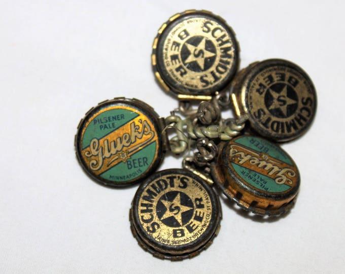 Collection of Five Vintage Kork-N-Seal bottle caps with advertising for Gluek's Beer, Schmidt's Beer