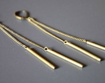 Long silver chain and tube earrings