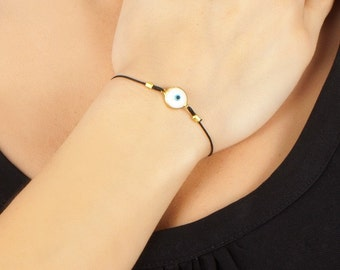 White Evil eye Bracelet In Gold Coated Silver with black thread