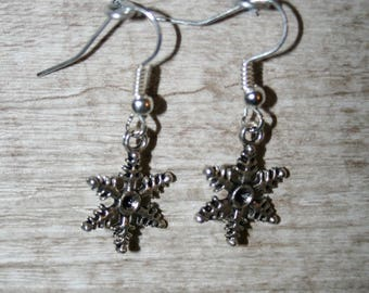 earrings with charms or charms in silver snowflakes