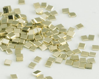 14k yellow gold chip Solder - estimated 90 chips but it could be half that. I weigh it. - It is about 1/4 gram - Cadmium Free