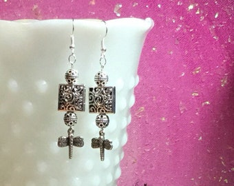 Antique silver with scrollwork square earrings with silver dragonflies dangles.