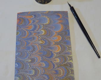 Blue, gold, orange and cream hand marbled paper hand sewn notebook