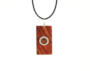 Wooden necklace that can be worn as a pendant on a strip of leather or at the neck on a hoop