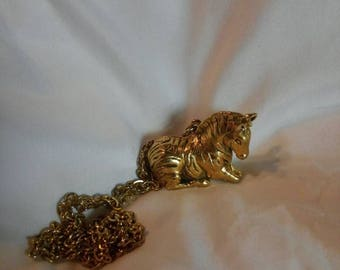 Max Factor zebra perfume necklace ( gold plated)