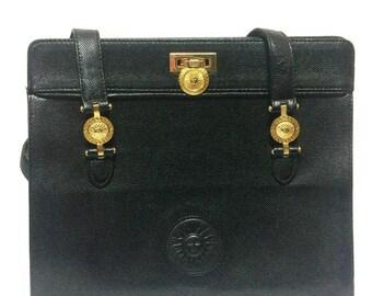 Vintage Gianni Versace black leather tote bag with golden sunburst motifs. Lady Gaga style shoulder bag for daily use.