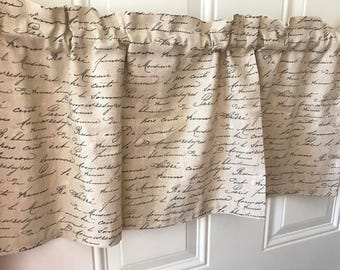 Tan with black french script curtain valance