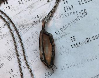 Caged quartz necklace