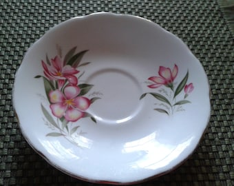 Group of 4 imported vintage tea cup saucers