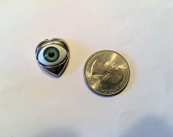 Eyeball in Mouth Heart Needle Minder Creepy eye
