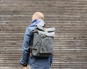 Waxed canvas backpack with roll to close top and vegetable tanned leather shoulderstraps