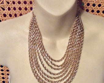 Multi strand chains bib necklace. 8 strands gold toned chains.