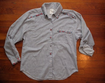 women's vintage button up with fabric covered buttons.