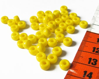 Set of 46 opaque 6mm x 4mm glass yellow pony beads