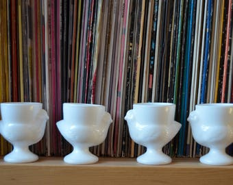 Set of 4 vintage French pressed glass egg cups with chickens in white