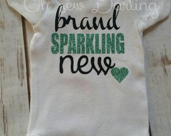 Brand *Sparkling* New baby onesie. Glitter heat press vinyl!