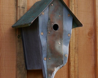 Handcarved  Bird house with a copper roof