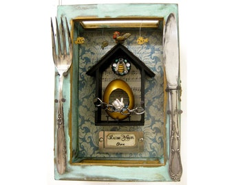 Raise Your Own. Eggshell, paper, metal and found objects in reclaimed wooden and glass box. 21 x 15cm. (8 x 6 inches.)