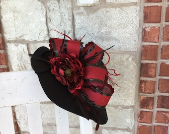 Black felt hat with red accents