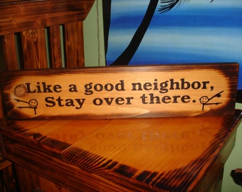 Like a good neighbor, stay over there. Hand painted sign