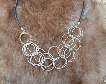 Silver Rings Sculptural necklace -vintage hammered silver with leather cord OOAK
