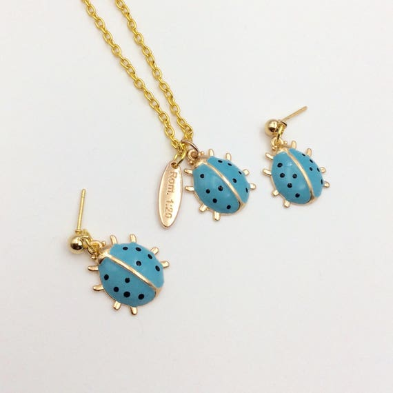 "Creation Series ""Blue Lady Bug""  Charm Pendant w/chain and Rom 1:20 tag, Matching earrings optional.  Gold plated enamel."