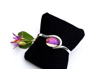 Silver plated over copper cuff bracelet with dichroic cabochon in red purple and silver