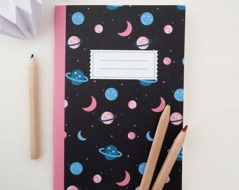 A6 notebook illustrated with planets and stars