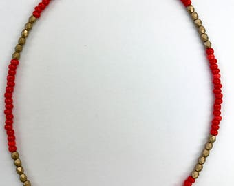 Red and gold necklace with a hand painted bead