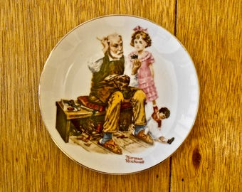 Norman Rockwell 6 1/2 inch plate - The Cobbler