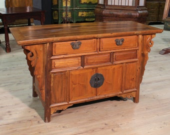 Oriental sideboard in carved wood