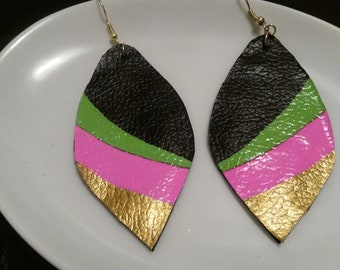 Beautiful handcrafted and painted faux leather earrings.