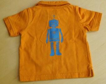 Robot and heart on orange polo shirt
