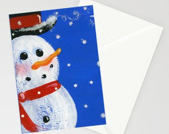 Snowman - Folk Art Winter Christmas Card with a whimsical snowman wearing his red scarf and top hat over a blue background during snowfall