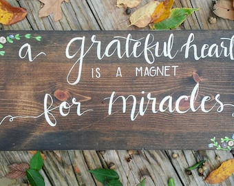 A grateful heart is a magnet for miracles hand lettered wood sign hand painted grateful heart sign