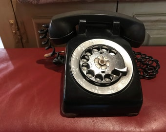 Vintage, Western Electric-made in the USA black rotary phone.