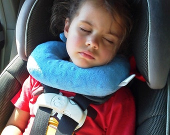 A travel pillow for children in forward facing car seats that offers chin and head support. This pillow eliminates the forward head slump!