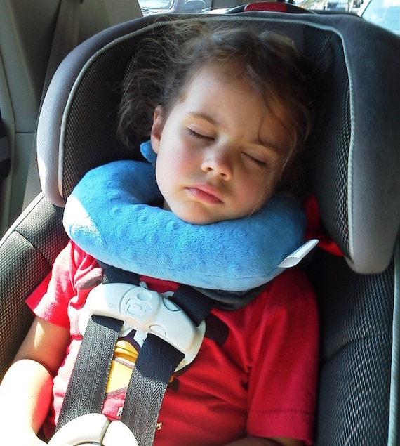 A Travel Pillow For Children In Forward Facing Car Seats That