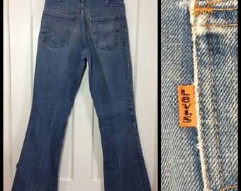 distressed 1970's Levi's 646 orange tab measures 32x32 faded Blue Denim Bell Bottom Flare boyfriend Jeans Scovill zipper #39 button #283