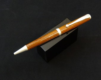 Handmade twist ink pen with a Mahogany main body by Specialty Turned Designs