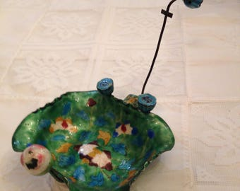 antique cloissone enamel container with floral decorations and a small frog. circa 1930's