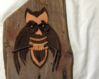 Leather owl on barn board