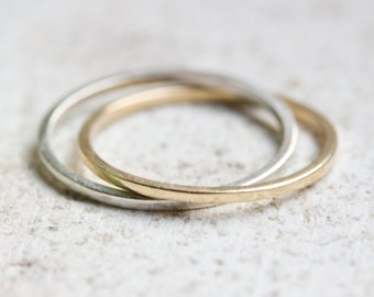 Interlocked rings made of sterling silver and brass - infinity rings - rolling ring