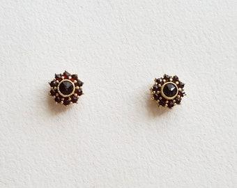 Small sized garnet stud earrings, gold on silver,  1960s  (F1423)