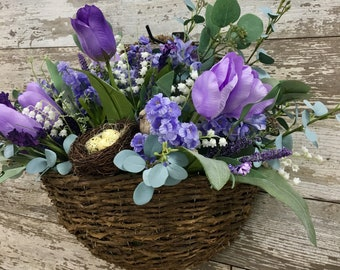Hanging Grapevine Basket with Tulips, Eucalyptus, and Bird by The Chattanooga Wreath Company