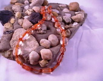 Beads with an inside color strip of orange